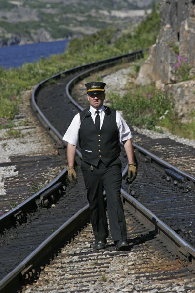 Conductor on tracks by Kelly Braden