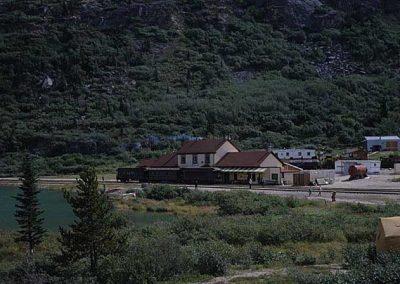 Bennett Station with 3 cars in front. Location:Bennett. Milepost:. Date:1979-10-00