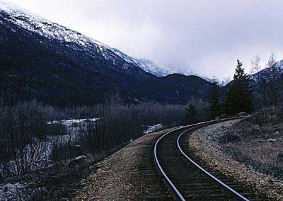 Curve at Gold Rush cementry with Skagway river. Location:Skagway. Milepost:Mile 2. Date:27845