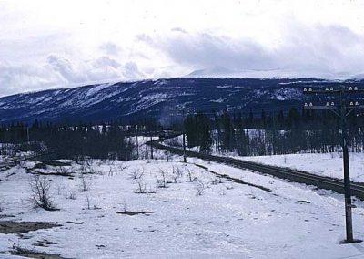 Northbound train near Carcross dessert. Location:MP 68.2. Milepost:Mile 68.2. Date:1980-03-00