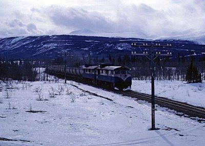 Northbound train near Carcross dessert, closer view. Location:MP 68.2. Milepost:Mile 68.2. Date:1980-03-00