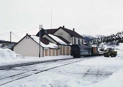 Bennett Station with unloading of freight. Location:Bennett. Milepost:.