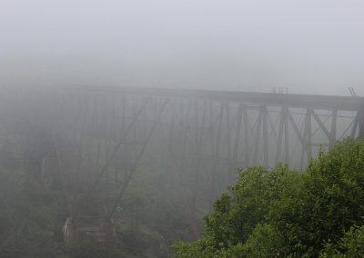 Old Steel Bridge Enveloped in Fog